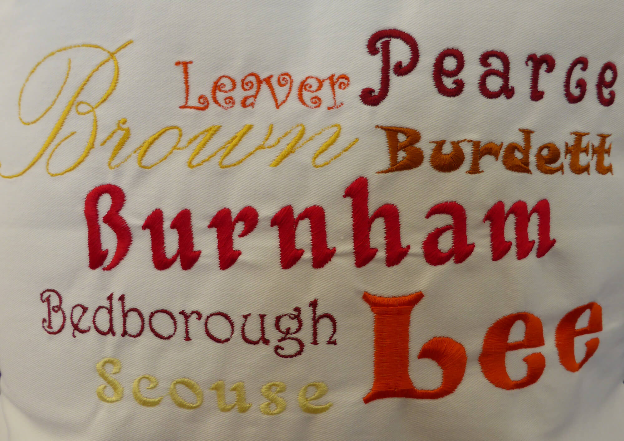 Close up of Ancestors' Surnames Cushion Cover (embroidered)